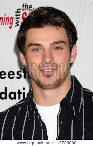 LOS ANGELES - OCT 9:  Adam Gregory arrives at the