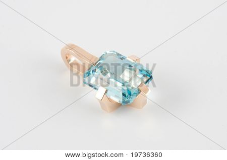 gold coulomb with gem