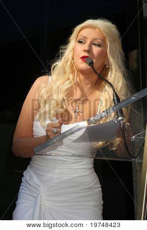 LOS ANGELES - NOV 15: Christina Aguilera at the Hollywood Walk of Fame Star Ceremony for Christina Aguilera at Hard Rock Cafe Sidewalk, Hollywood & Highland on November 15, 2010 in Los Angeles, CA