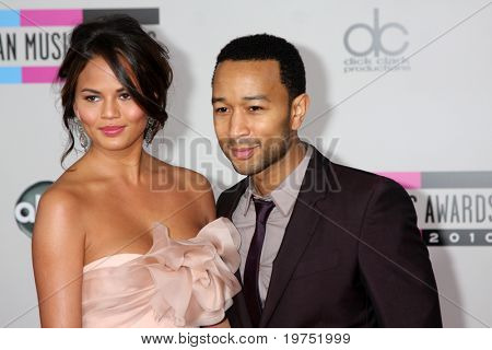LOS ANGELES - NOV 21:  Christine Teigen; John Legend  arrives at the 2010 American Music Awards at Nokia Theater on November 21, 2010 in Los Angeles, CA