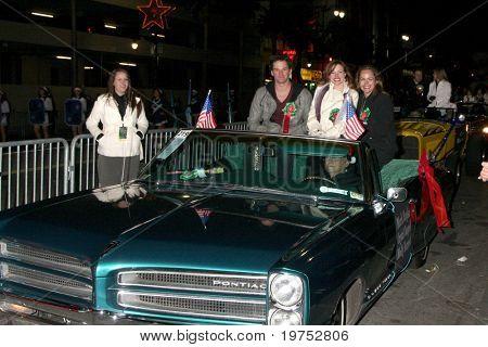 LOS ANGELES - NOV 28:  Mark Hapka, Moly Burnett, Chrystal Chappell arrive at the 2010 Hollywood Christmas Parade at Hollywood Boulevard on November 28, 2010 in Los Angeles, CA
