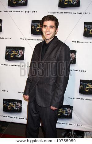 LOS ANGELES - DEC 2: Travis Ellenberger arrives at the