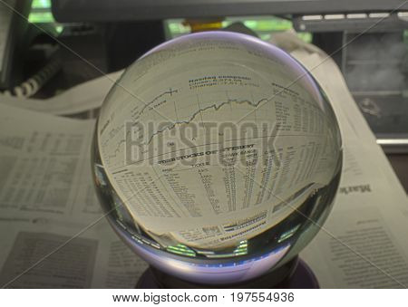 HDR Photo image of stock market graph through a crystal ball