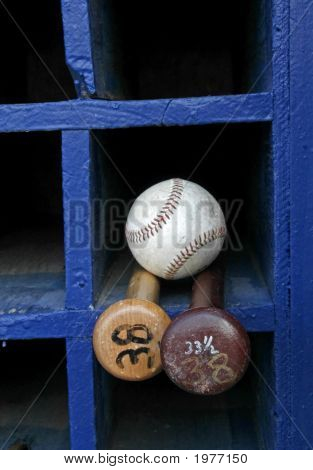 Two Baseball Bats And A Ball