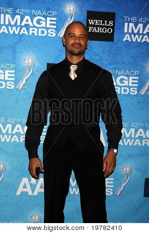 LOS ANGELES - FEB 12:  Dondre T. Whitfield arrives at the 2011 NAACP Image Awards Nominee Reception at Beverly Hills Hotel on February 12, 2011 in Beverly Hills, CA