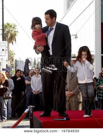 LOS ANGELES - FEB 1:  Adam Sandler, with daughters Sunny & Sadie at the Adam Sandler Hollywood Walk of Fame Star Ceremony at W Hotel on February 1, 2011 in Hollywood, CA