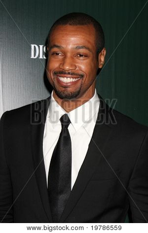 LOS ANGELES - FEB 22:  Isaiah Mustafa arrives at the 13th Annual Costume Designers Guild Awards at Beverly Hilton Hotel on February 22, 2011 in Beverly Hills, CA