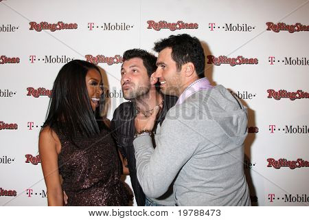 LOS ANGELES - FEB 26:  Brandy Norwood, Maksim Chmerkovskiy, Tony Dovolani,  arrives at the Rolling Stone Pre-Oscar Bash 2011 at W Hotel on February 26, 2011 in Hollywood, CA