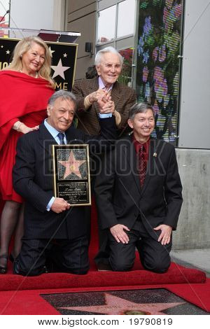 LOS ANGELES -  MARCH 1: Attendees at Maestro Zubin Mehta's Hollywood Walk of Fame ceremony pose for a photo on March 1, 2011 in Los Angeles, CA. Pictured are (front row, l-r) Maestro Zubin Mehta with an unidentified Hollywood Chamber guest and (back row,