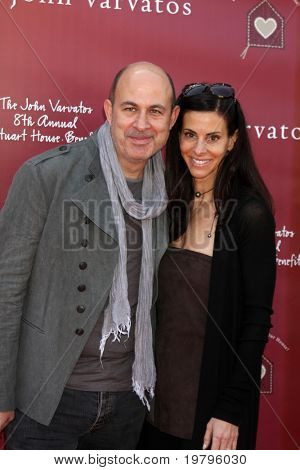 LOS ANGELES - MAR 13:  John Varvatos, Joyce Varvatos arriving at the John Varvatos 8th Annual Stuart House Benefit at John Varvaots Store on March 13, 2011 in Los Angeles, CA