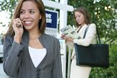 image of clientele  - A beautiful young real estate agent woman on the phone - JPG