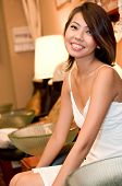 stock photo of nail salon  - A young pretty asian woman sitting in a nail salon - JPG