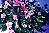 picture of flower arrangement  - Flower arrangement sitting atop a casket in the viewing room - JPG