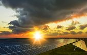 Solar Panels At Sunrise With Cloudy Sky In Normandy, France. Solar Energy, Modern Electric Power Pro poster