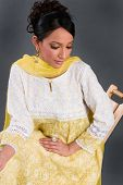 stock photo of salwar-kameez  - A model wearing a suit with traditional Indian brocade embroidery - JPG