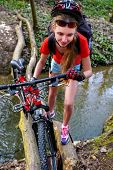 Bikes cycling girl. Girl rides bicycle. Girl cycling fording throught water. Cycling trip is good fo poster