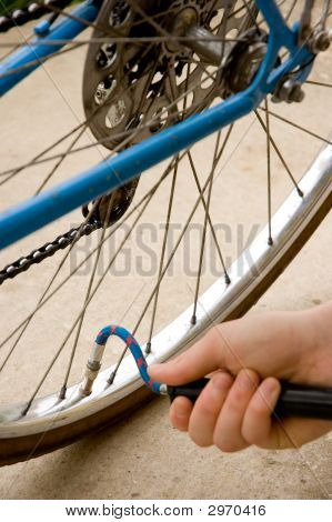 Inflating The Tire Of A Bicycle
