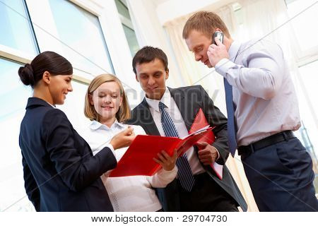 Image of business people consulting during paperwork