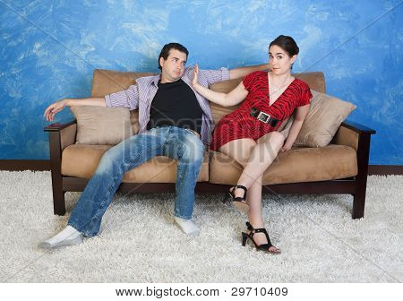 Woman Pushes Man Away