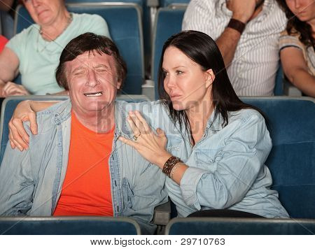 Woman Pacifies Weeping Man