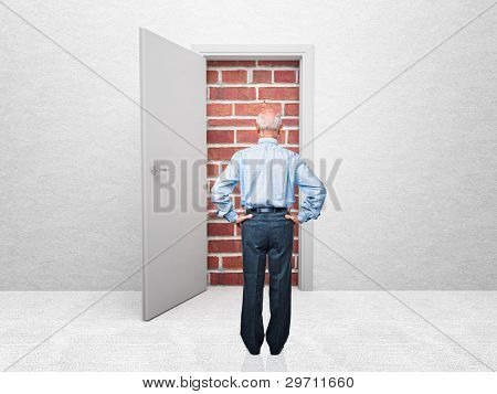 standing old man and door with brick wall