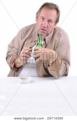 Horrified Man In His 50S Sitting At A Table With A Beer