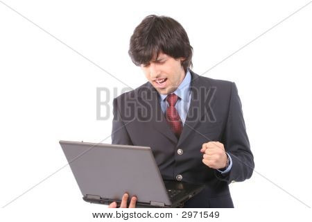 Young Happy Business Man Working With Laptop