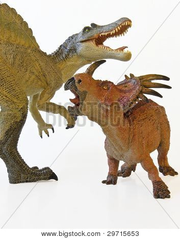 A Spinosaurus And Styracosaurus Battle With White Background
