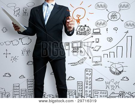 businessman with marker writing something