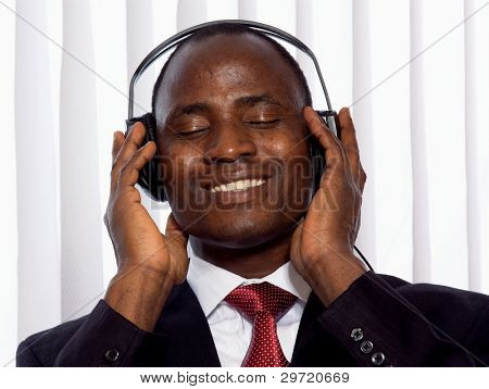 Portrait of a smiling Afro-American businessman with headset