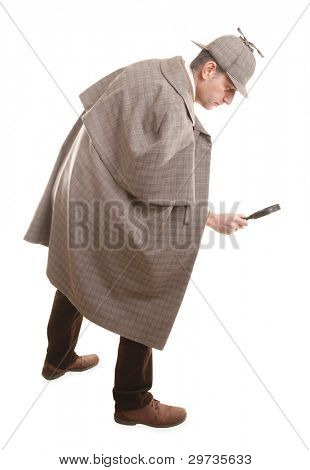 Detective Sherlock Holmes following tracks with magnifying glass