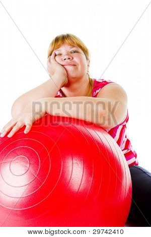 tired fat woman with big red gymnastic ball