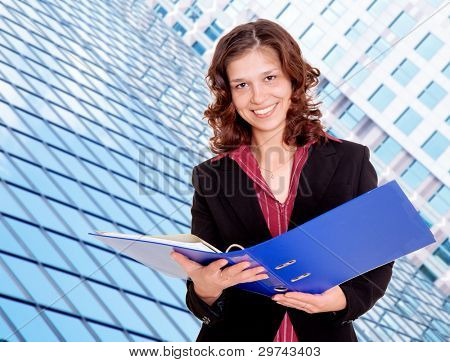 Young smiling woman with portfolio folder