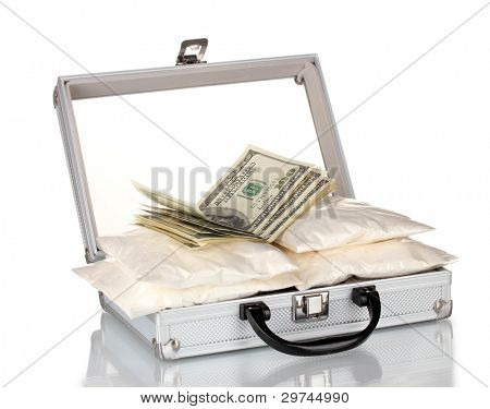 Cocaine with money in a suitcase isolated on white