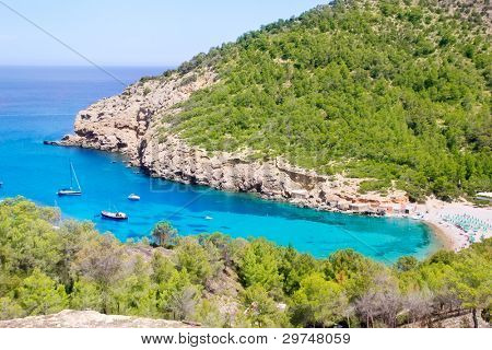 Ibiza Port de Benirras beach with turquoise mediterranean sea in Spain