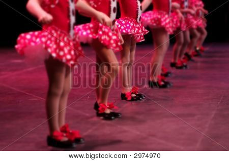 Dancing On Stage In Bright Red