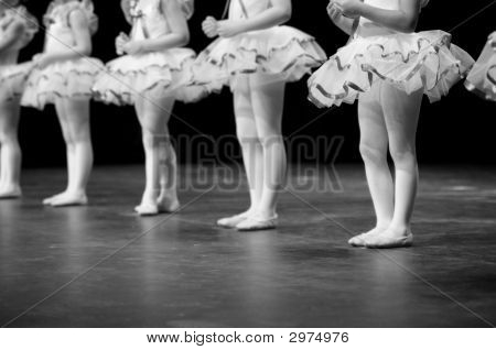 Dancers Performing On Stage In B&W