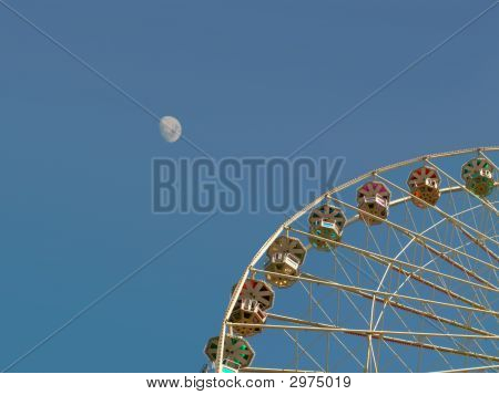 Big Ferris Wheel In Front Of The Moon