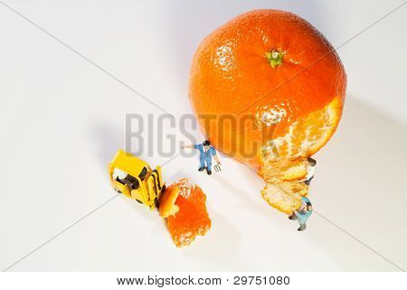 Two Figurines, An Orange And A Forklift