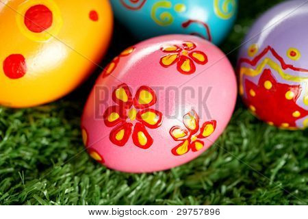 Hand painted Easter eggs lying on the lawn