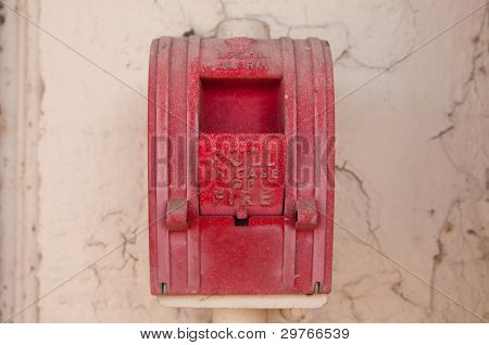 Vintage Red Wall Fire Alarm On Stucco Wall