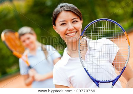 Female tennis player at the court playing doubles