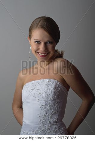 Beautiful Young Woman Laughing In An Elegant White Corset Isolated
