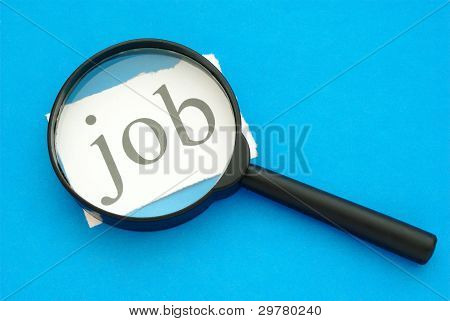 Magnifying Glass And A Piece Of Paper