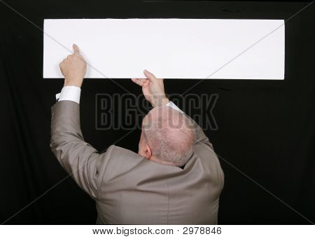 Man Pointing To Blank Sign