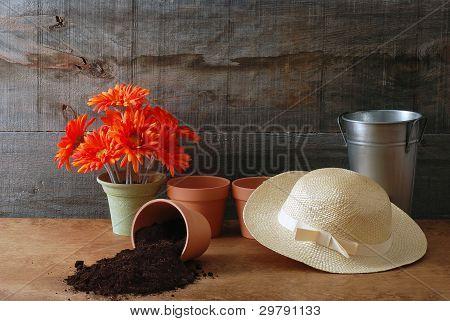 Gardening still life with ladies straw hat