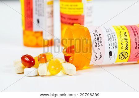 Vitamins Spilling From Prescription Bottle