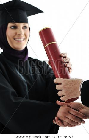 Young arabic muslim female graduating and receiving diploma