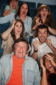 pic of horrifying  - Group of seven horrified men and women react - JPG