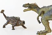foto of ankylosaurus  - Ankylosaurus and Allosaurus battle it out against a white background - JPG